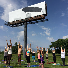 yoga under billboard